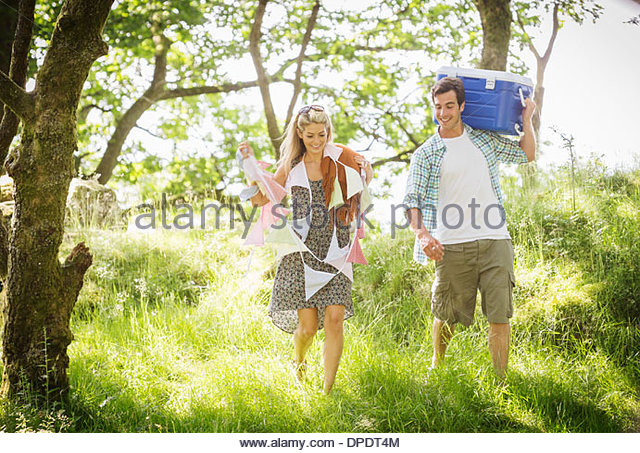 Young couple in forest with bunting and cool box - Stock-Bilder