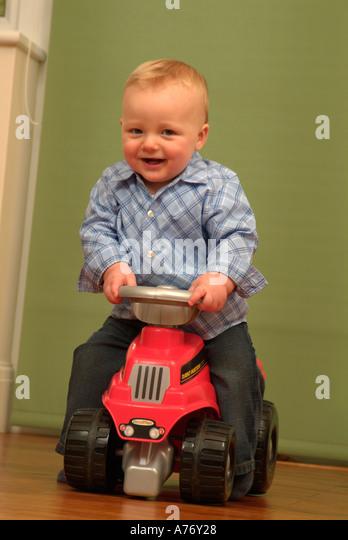 Boy Ride On Toys : Toddler riding toy car stock photos