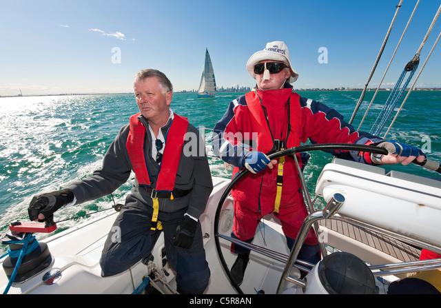 The captain is steering an Ocean going yacht. - Stock-Bilder