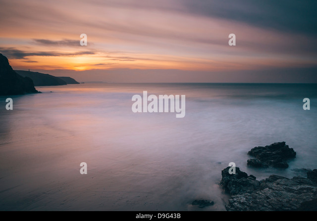 Porthtowan beach looking along the Cornish coastline at sunset, Porthtowan, Cornwall, England, UK - Stock Image