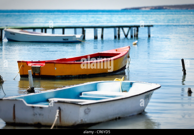 Small Fishing Boats Moored in a Bay, Cana Gorda, Guanica, Puerto Rico - Stock Image