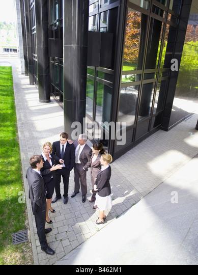 Germany, Baden-Württemberg, Stuttgart, Businesspeople talking, elevated view - Stock Image