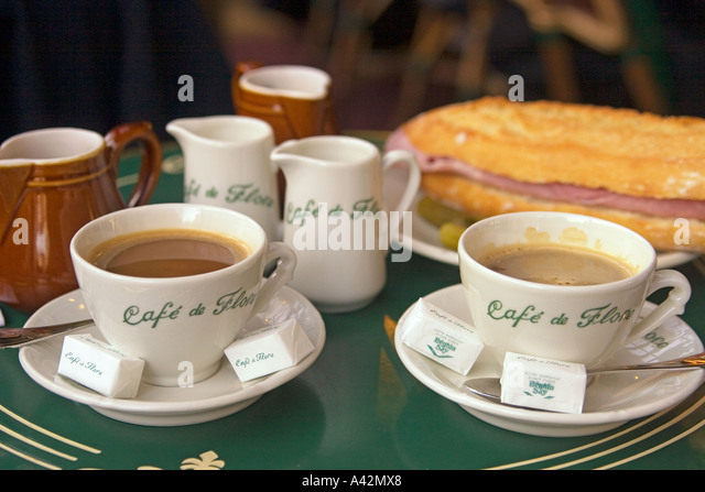 Paris St German Cafe de Flore table with cafe creme and sandwich - Stock Image