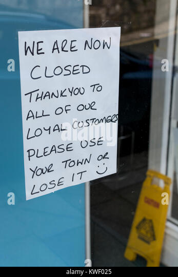 Window sign saying that a high street shop has closed its doors for the last time - metaphor for recession, struggling - Stock Image