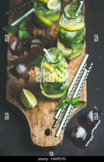 Dieting healthy infused citrus sassi water in glass bottle - Stock Image