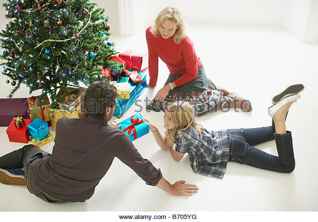Family opening Christmas gifts - Stock Image