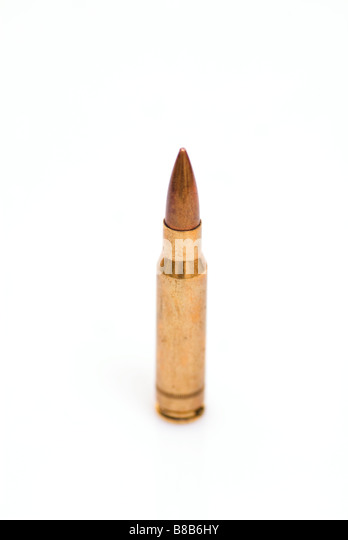 One single bullet on a white background - Stock Image