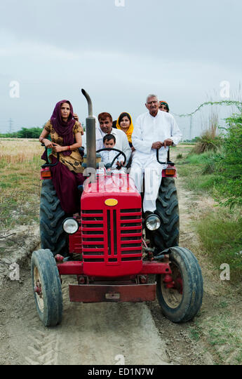 Woman Farmer Driving Old Tractor Stock Photos & Woman ...