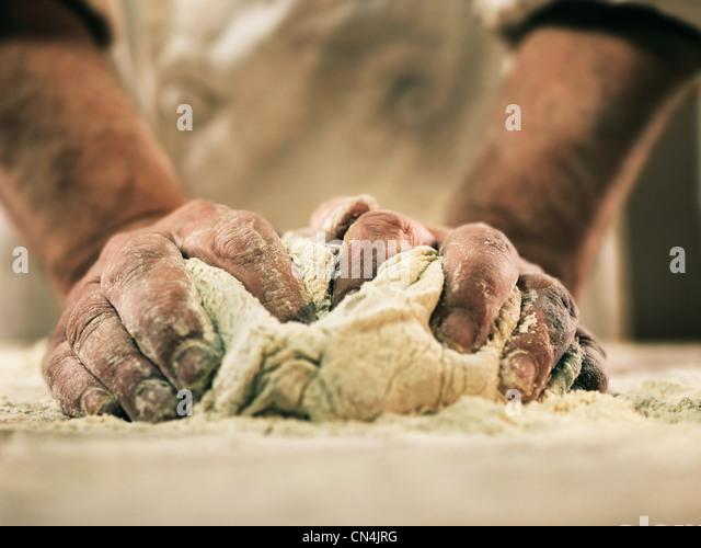 Baker kneading dough - Stock-Bilder