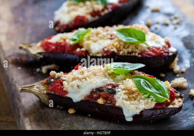 Roast aubergines with tomatoes and  mozzarella - Stock Image