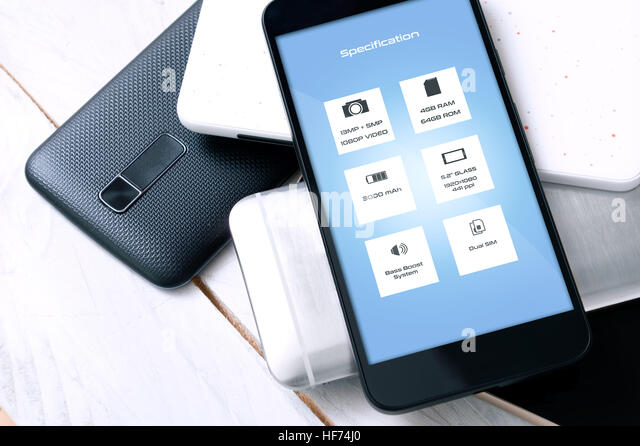 Smartphone with specification on screen laying on another unknown smartphones. Concept of making a decision which - Stock Image