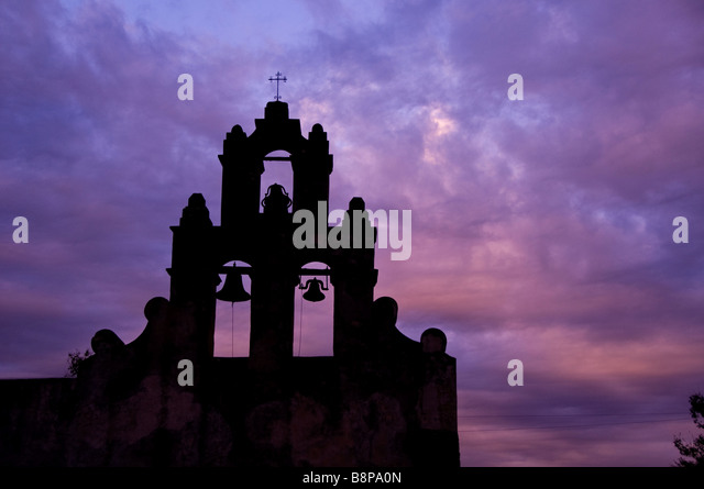Mission San Juan Antonio bell tower san juan antonio texas tx early morning dramatic blue sky - Stock Image