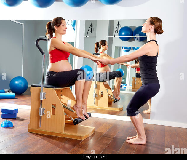 Woman Pilates Chair Exercises Fitness Stock Photo: Woman On Stability Chair Stock Photos & Woman On Stability