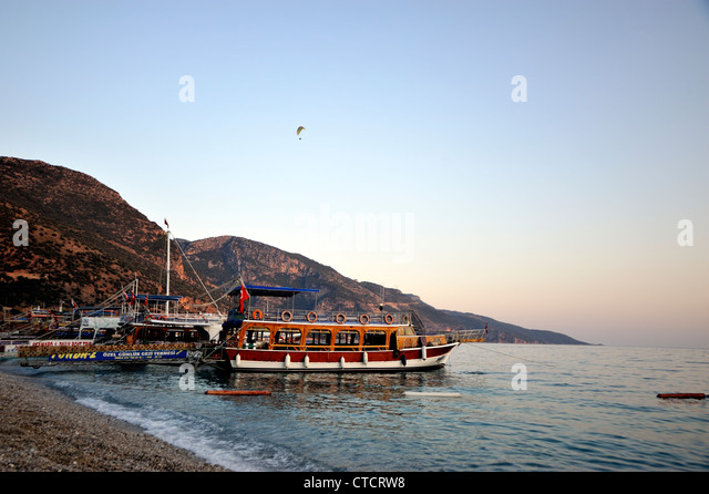Boats moored by the beach, Olu Deniz, Turkey - Stock Image
