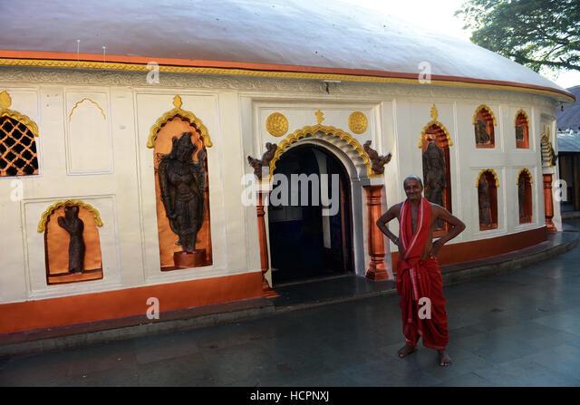 A Hindu priest outside the main temple hall in Kamakhya temple in Guwahati. - Stock Image