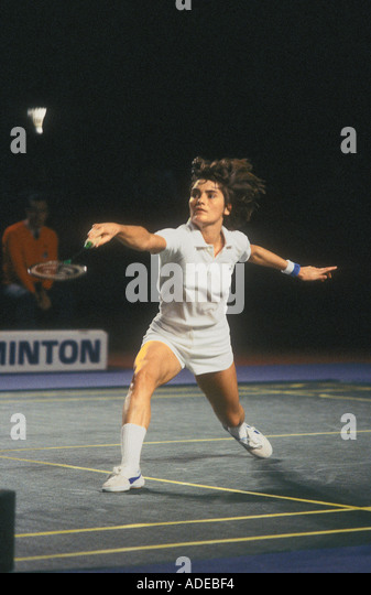 Singles Badminton Player in action - Stock Image