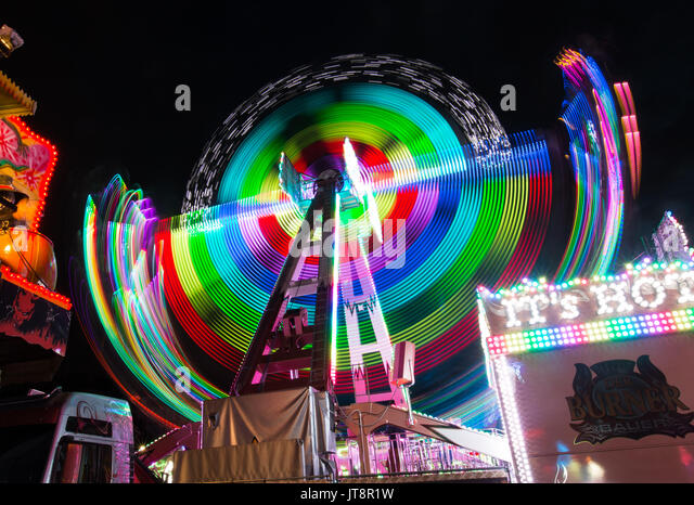 Geneva. 8th Aug, 2017. The long-exposure photo taken on Aug. 8, 2017 shows an illuminated ferris wheel at a summer - Stock Image