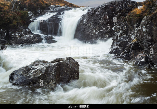 River Sligachan in spate due to heavy rain flows below the Cuillin Hills on the Isle of Skye, Scotland - Stock Image