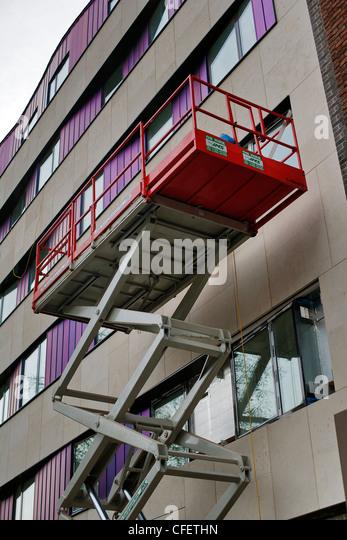 Mobile elevating work platform in use on external building refurbishment, - Stock Image