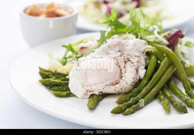 Breakfast with asparagus and egg - Stock Image