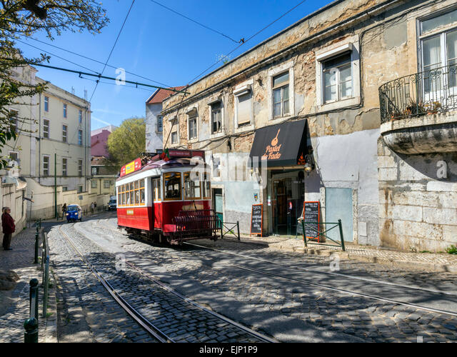 Tram and fado bar in the Alfama district of Lisbon, Portugal - Stock Image