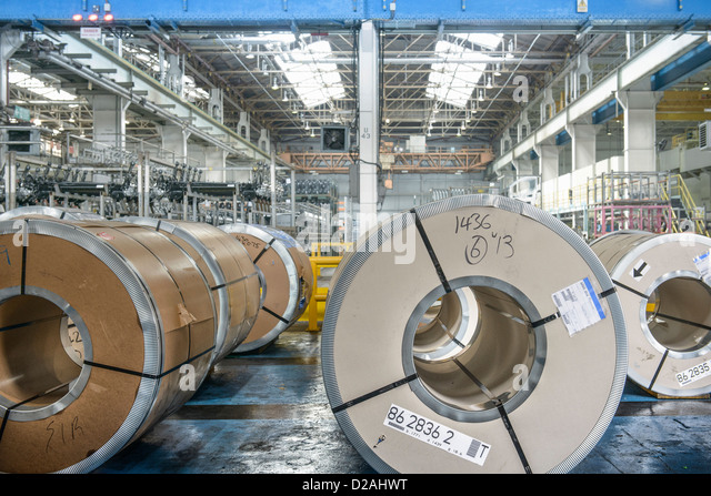 Rolls of steel in car factory - Stock Image