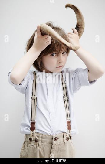 Boy posing with animal horn - Stock-Bilder