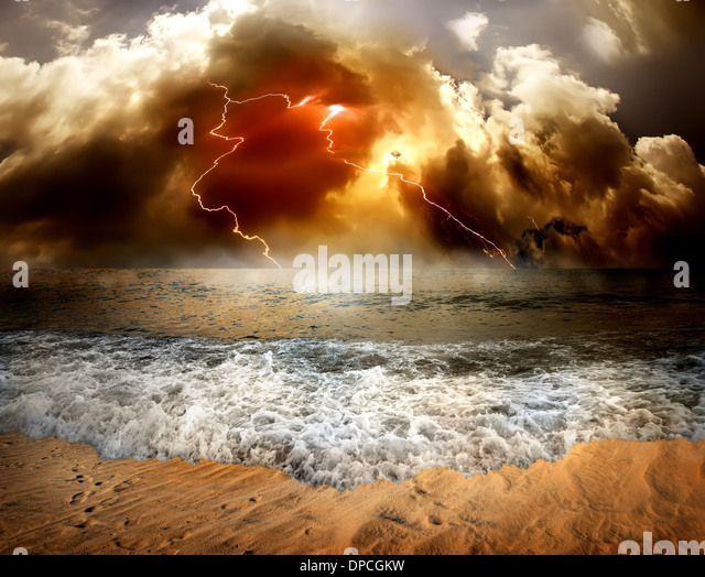 Storm clouds and lightning over the sea - Stock Image