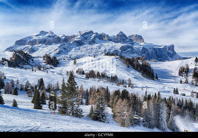 Landscape of the italian alps in a winter morning with clouds at the horizon, Dolomites Alta Badia - Stock Image