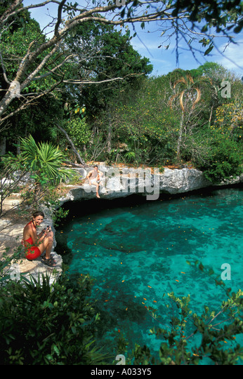 Mexico Yucatan couple at Xel-Ha Lagoon tourist attraction riviera maya near Playa del Carmen Mexican caribbean coast - Stock Image