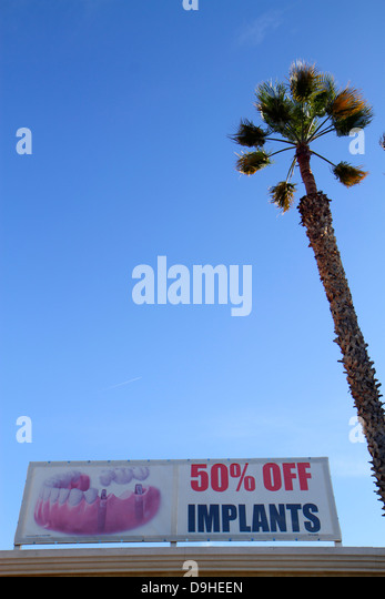 Nevada Las Vegas West Sahara Avenue sign advertising offer 50% implants dental - Stock Image