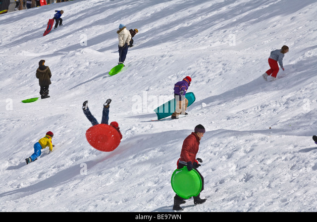 Sledding at snow play area at NAU practice field, in Flagstaff, Arizona - Stock Image
