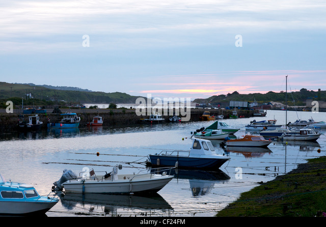 Boats at Hayle Estuary in Cornwall when the tide is out boats accessible sunset dusk - Stock Image