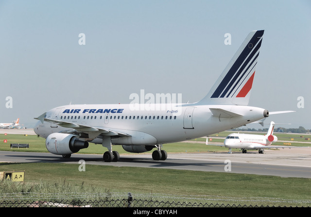 Air France Airbus A318-100 (F-GUGI) taxiing after landing at Manchester Airport, England. - Stock Image