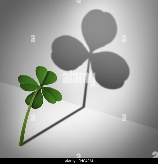 Low self esteem psychological concept as a four leaf clover casting a shadow with only three leaves as a mental - Stock-Bilder