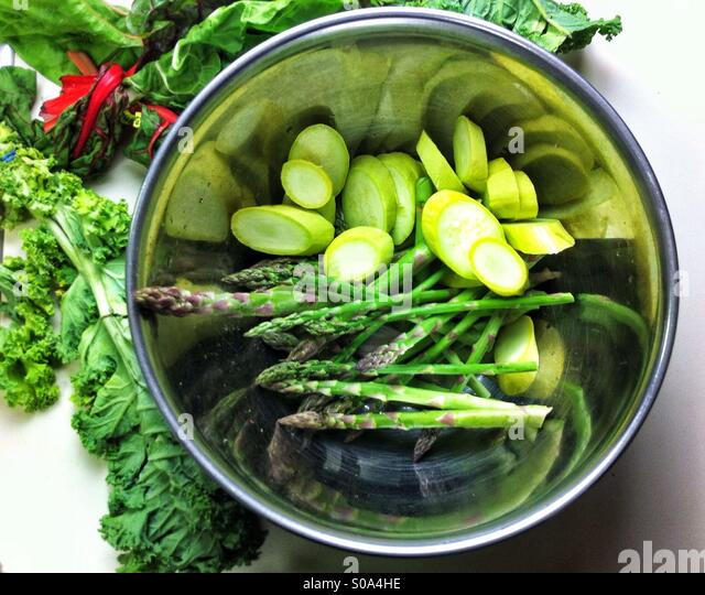 Metal pot with prepared green vegetables for cooking - Stock Image