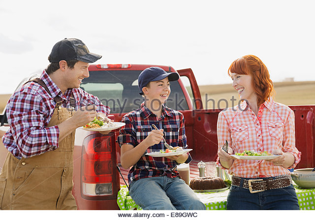 Family enjoying lunch on farm - Stock Image
