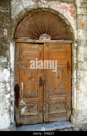 Old wooden doorway, Rhodes, Greece - Stock Image