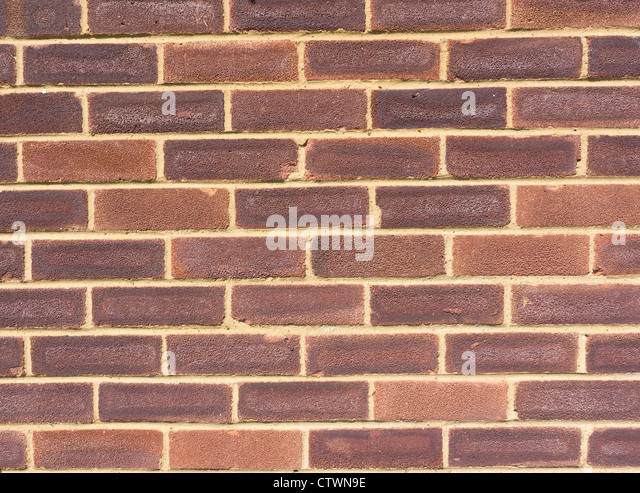 Close on a section of a brick wall facade - Stock-Bilder