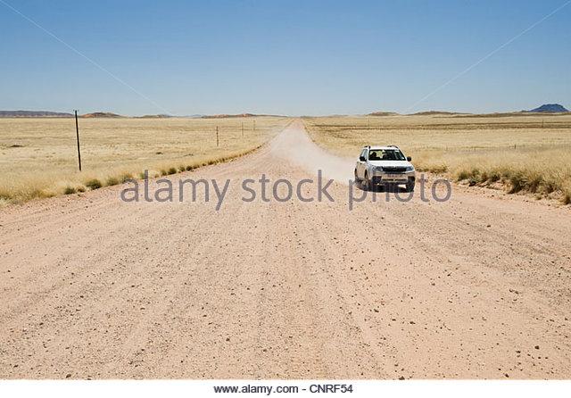 Desolate road through Namib Desert, Namibia - Stock Image