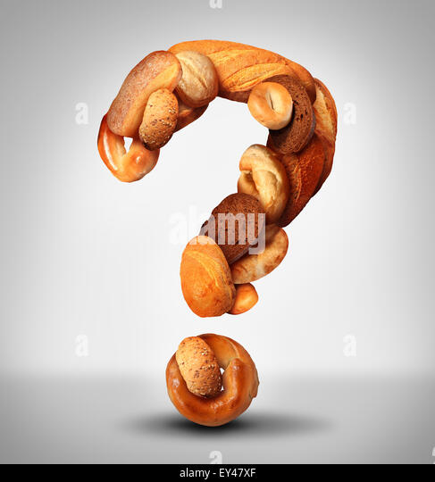 Bread questions food concept with a group of baked goods from a bakery or home cooking shaped as a question mark - Stock-Bilder