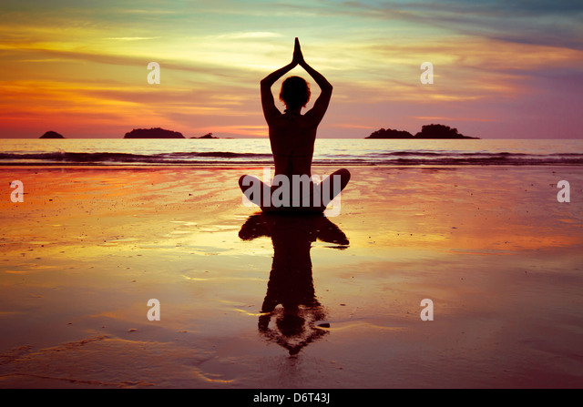 yoga on the beach - Stock Image