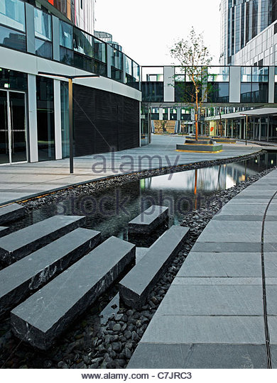 Pond in courtyard of modern building - Stock Image