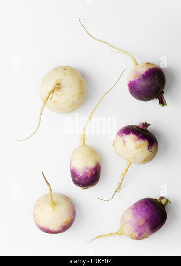 Fresh turnips over white background. Above view. - Stock Image