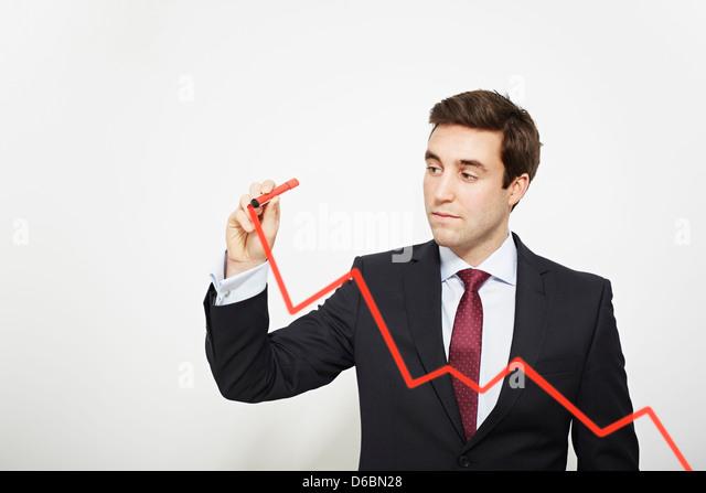 Businessman drawing graph in air - Stock-Bilder