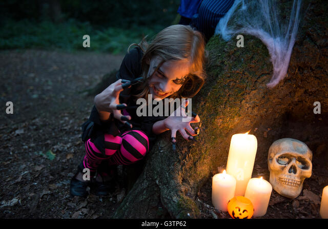 A young girl dressed in costume for Halloween Night. - Stock Image