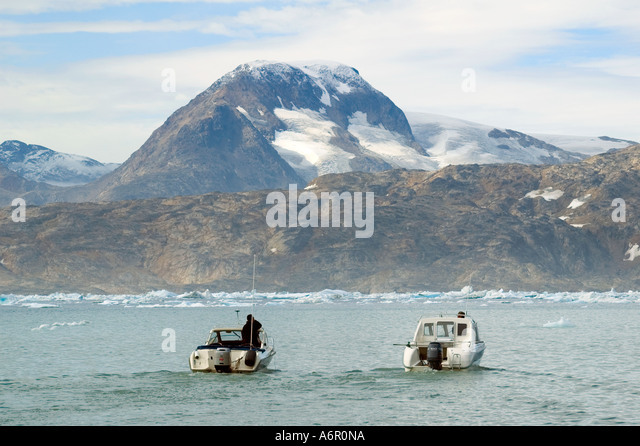 Two Inuit boats on Sermilik Fjord, East Greenland - Stock Image