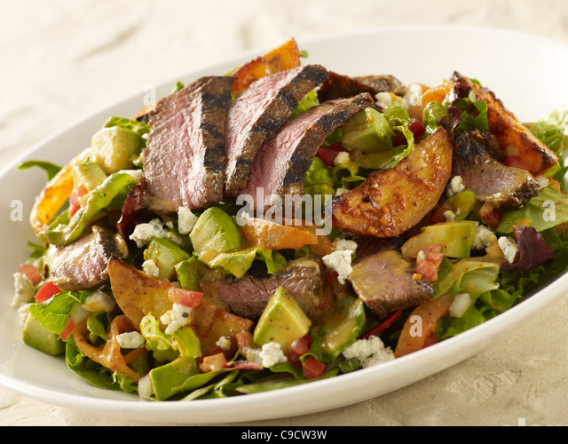 Grilled steak and potato salad - Stock Image