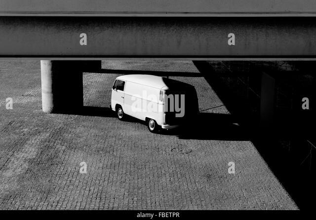 Low Angle View Of Van Below Building In Parking Lot - Stock-Bilder