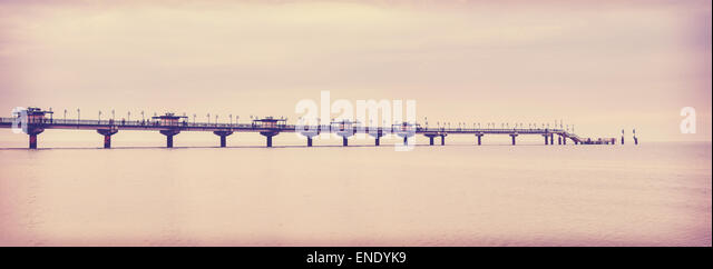 Retro vintage filtered picture of long pier in Miedzyzdroje, Poland. - Stock Image